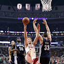Chicago Bulls forward Mike Dunleavy (34) loses control of the ball as he drives between Memphis Grizzlies forward Zach Randolph (50) and Marc Gasol (33) during the first half of an NBA basketball game on Friday, March 7, 2014, in Chicago The Associated Pr