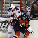 New York Rangers' Rich Nash (61) and Florida Panthers' Tomas Kopecky (72) battle for the puck during the third period of an N