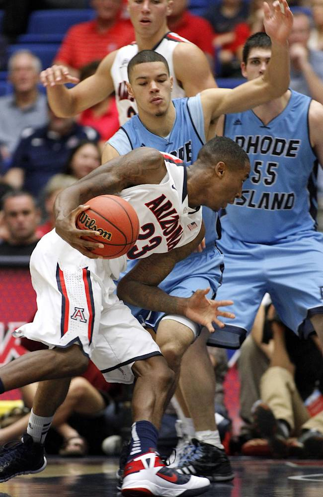 Arizona's Rondae Hollis-Jefferson (23) drives to the basket against the pressing defense of Rhode Island's Jarelle Reischel in the second half of an college NCAA basketball game, Tuesday, Nov. 19, 2013 in Tucson, Ariz. This is in the second round of the NIT. Arizona won 87 - 59