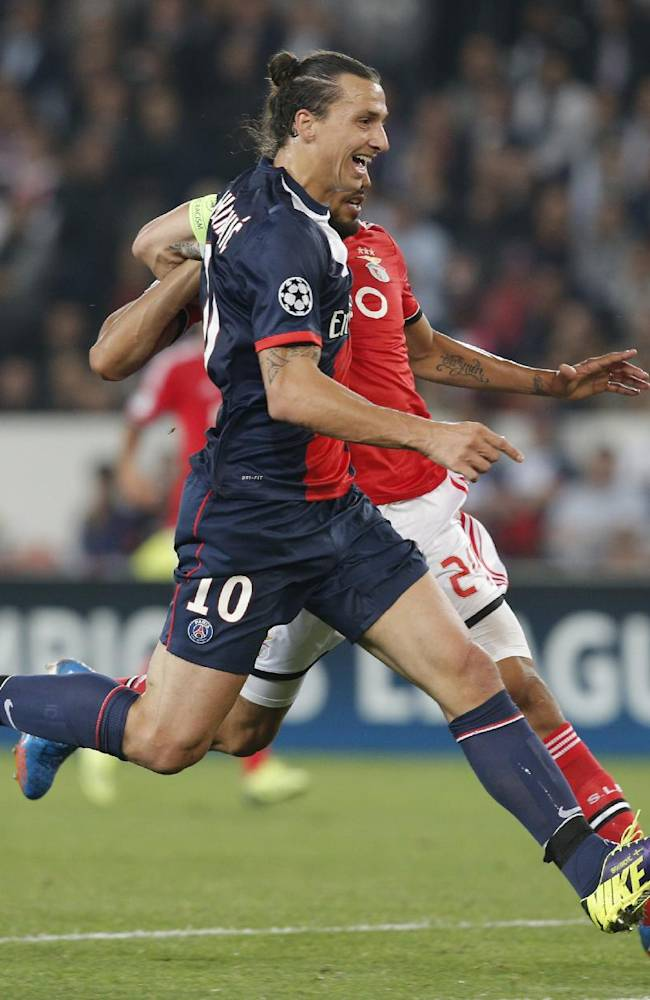 PSG's Zlatan Ibrahimovic, front, challenges for the ball with Benfica's Ezequiel Garay during the Champions League group C soccer match between Paris Saint Germain and Benfica, at the Parc des Princes stadium, in Paris, Wednesday, Oct. 2, 2013