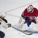 Buffalo Sabres' Chris Stewart scores against Montreal Canadiens goaltender Dustin Tokarski during third period NHL hockey action in Montreal, Saturday, Nov. 29, 2014 The Associated Press