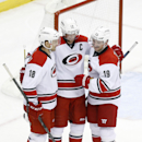 Carolina Hurricanes' Jiri Tlusty (19) celebrates an empty net goal with teammates Jay McClement, and Eric Staal in the third period of an NHL hockey game against the Pittsburgh Penguins, Friday, Nov. 28, 2014 in Pittsburgh. The Hurricanes won 4-2 The Asso