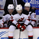 New Jersey Devils' Jaromir Jagr (68), of the Czech Republic, sits with Steve Bernier (18) and Ryan Carter (20) during the third period of a 7-4 loss to the Detroit Red Wings in an NHL hockey game Friday, March 7, 2014, in Detroit The Associated Press
