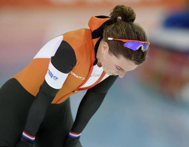 Silver medallist Ireen Wust of the Netherlands catches her breath after competing in the women's 5,000-meter speedskating race at the Adler Arena Skating Center during the 2014 Winter Olympics in Sochi, Russia, Wednesday, Feb. 19, 2014