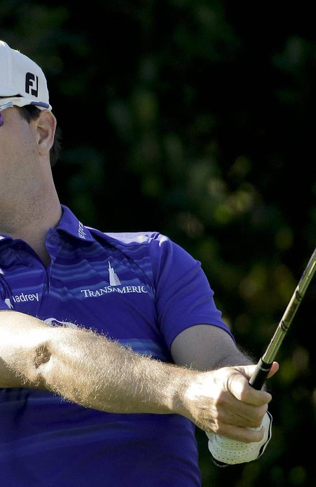 Zach Johnson watches his tee shot on third hole during the first round of the Humana Challenge golf tournament at the La Quinta Country Club on Thursday, Jan. 16, 2014, in La Quinta, Calif