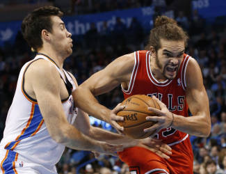 Chicago Bulls center Joakim Noah, right, drives past Oklahoma City Thunder forward Nick Collison during the first quarter of an NBA basketball game in Oklahoma City, Thursday, Dec. 19, 2013. (AP Photo/Sue Ogrocki)