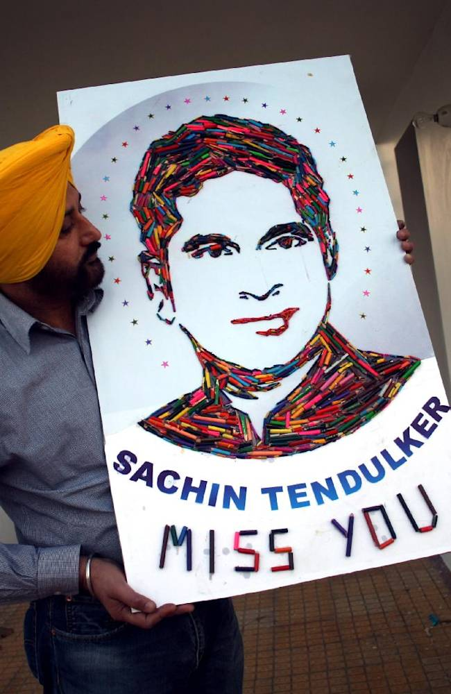 Indian artist Harwinder Singh Gill displays a portrait of Sachin Tendulkar made from colored pencils lead in Amritsar, India, Saturday, Nov. 16, 2013. Tendulkar played his last international cricket match Saturday that featured a cameo appearance bowling for a couple of overs, and a guard of honor from teammates as he walked from the field for the last time. Among his other prominent milestones include becoming the first man to score a double-century in limited-overs internationals (200 not out vs South Africa at Gwalior in 2010) and the first to reach 100 international centuries