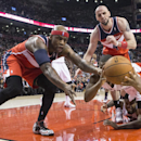 Washington Wizards' Al Harrington, left, Marcin Gortat, center left, Toronto Raptors' Kyle Lowry, center right, and Amir Johnston battle for a loose ball during second half NBA basketball action in Toronto, Thursday, Feb. 27, 2014 The Associated Press