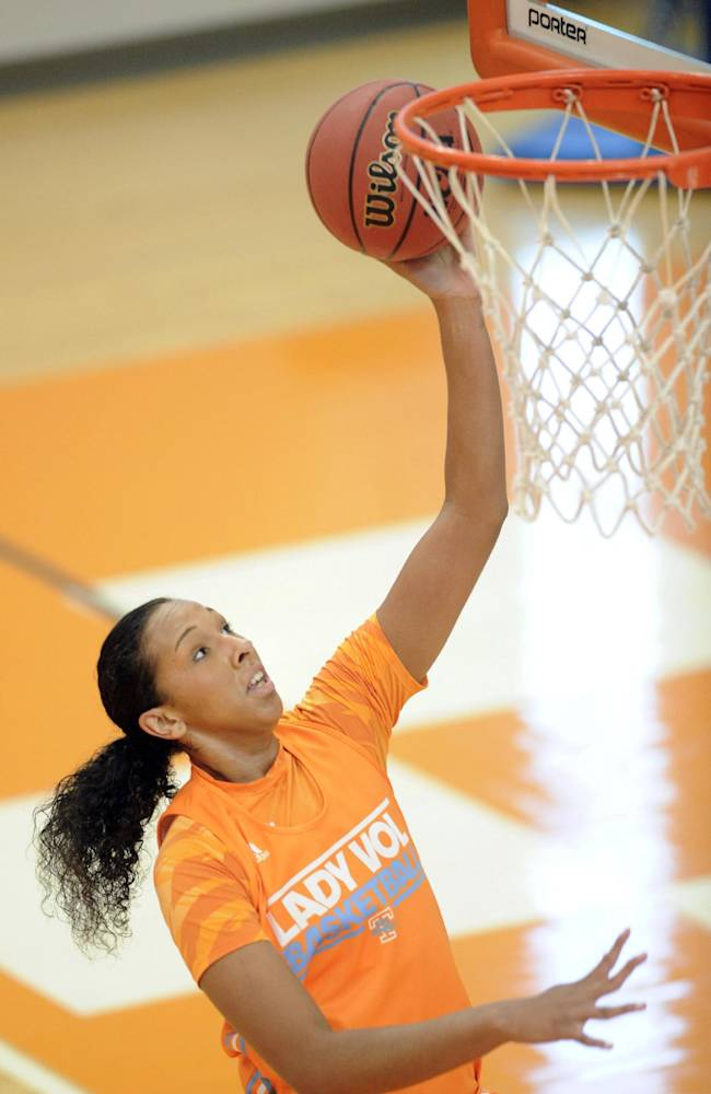 In this Oct. 1, 2013 file photo, Tennessee freshman Mercedes Russell shoots during NCAA college basketball practice in Knoxville, Tenn. Russell grew up rooting for Candace Parker and the Lady Vols. Now the 6-foot-6 freshman is about to begin her college career as Tennessee's most heralded incoming recruit since Parker's arrival on campus