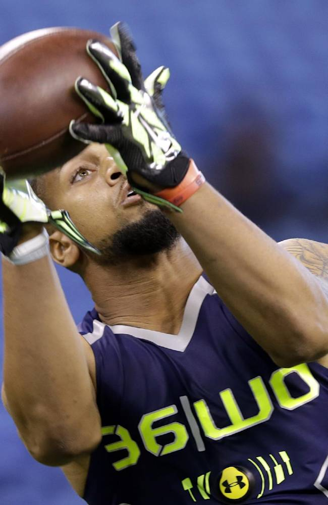 Mississippi wide receiver Donte Moncrief makes a catch during a drill at the NFL football scouting combine in Indianapolis, Sunday, Feb. 23, 2014