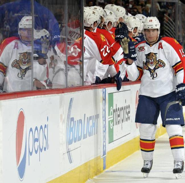 Florida Panthers right wing Scottie Upshall (19) is congratulated by teammates after scoring a goal against the Colorado Avalanche during the first period of an NHL hockey game on Saturday, Nov. 16, 2013, in Denver