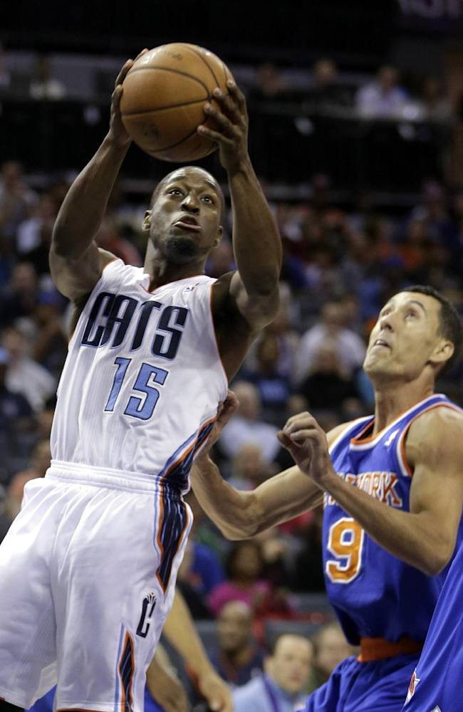 Charlotte Bobcats guard Kemba Walker, left, drives past New York Knicks guard Pablo Prigioni, of Argentina, in the first half of an NBA basketball game in Charlotte, N.C., Friday, Nov. 8, 2013