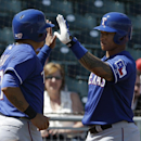 Texas Rangers' Shin-Soo Choo, left, is congratulated by Michael Choice after scoring during the first inning of a spring exhibition baseball game against the Cleveland Indians on Tuesday, March 25, 2014, in Goodyear, Ariz The Associated Press