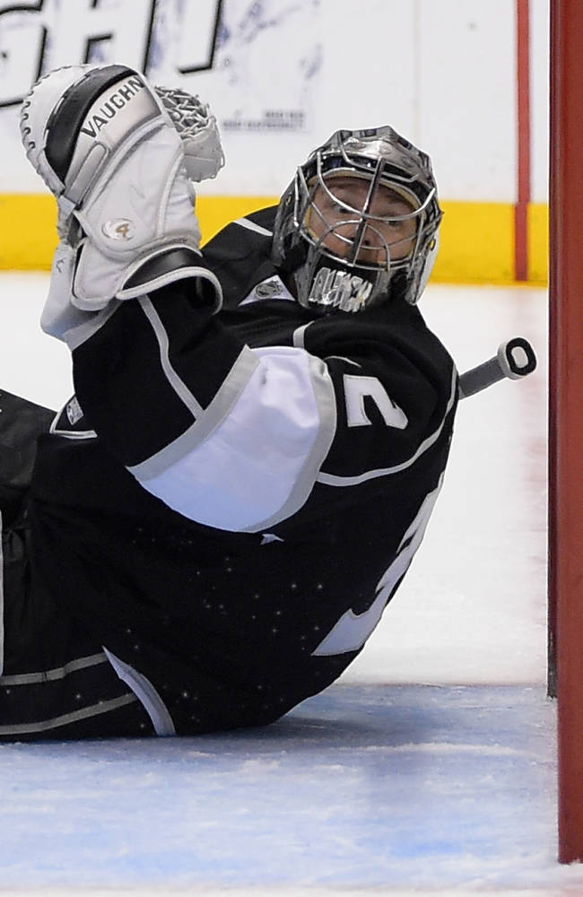Los Angeles Kings goalie Jonathan Quick is scored on by Anaheim Ducks right wing Devante Smith-Pelly during the first period in Game 4 of an NHL hockey second-round Stanley Cup playoff series, Saturday, May 10, 2014, in Los Angeles