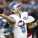 Detroit Lions' Matthew Stafford (9) is sacked by Arizona Cardinals' Jerraud Powers, back right, as Lions' Theo Riddick, left, is unable to protect him during the second half of an NFL football game Sunday, Nov. 16, 2014, in Glendale, Ariz. The Cardinals d