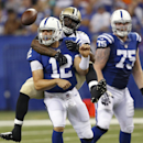 In this Aug. 23, 2014, file photo, Indianapolis Colts quarterback Andrew Luck (12) loses the ball as he's sacked by New Orleans Saints outside linebacker Junior Galette during the first half of an NFL preseason football game in Indianapolis. The Colts are