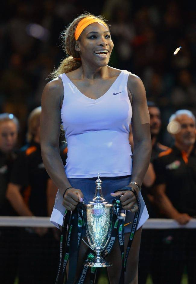 Serena Williams of the U.S shows her trophy after her victory over Li Na of China in the final of the WTA Championship in Istanbul, Turkey, Sunday, Oct. 27, 2013. The world's top female tennis players compete in the championships which runs from Oct. 22 until Oct. 27.(AP Photo)