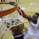 Houston Rockets' Dwight Howard (12) dunks during the first half in Game 2 of an opening-round NBA basketball playoff series against the Portland Trail Blazers Wednesday, April 23, 2014, in Houston. (AP Photo/David J. Phillip)