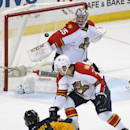 Buffalo Sabres defenseman Nikita Zadorov (51), of Russia, fires the game-winning goal past Florida Panthers defenseman Dmitry Kulikov (7), of Russia, and goaltender Al Montoya (35) during the overtime session of an NHL hockey game Saturday, Dec. 13, 2014,