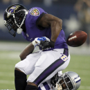 Baltimore Ravens running back Justin Forsett, top, fumbles the ball as he is tackled by Dallas Cowboys linebacker Rolando McClain (55) during the first half of an NFL preseason football game Saturday, Aug. 16, 2014, in Arlington, Texas. The ball was recov