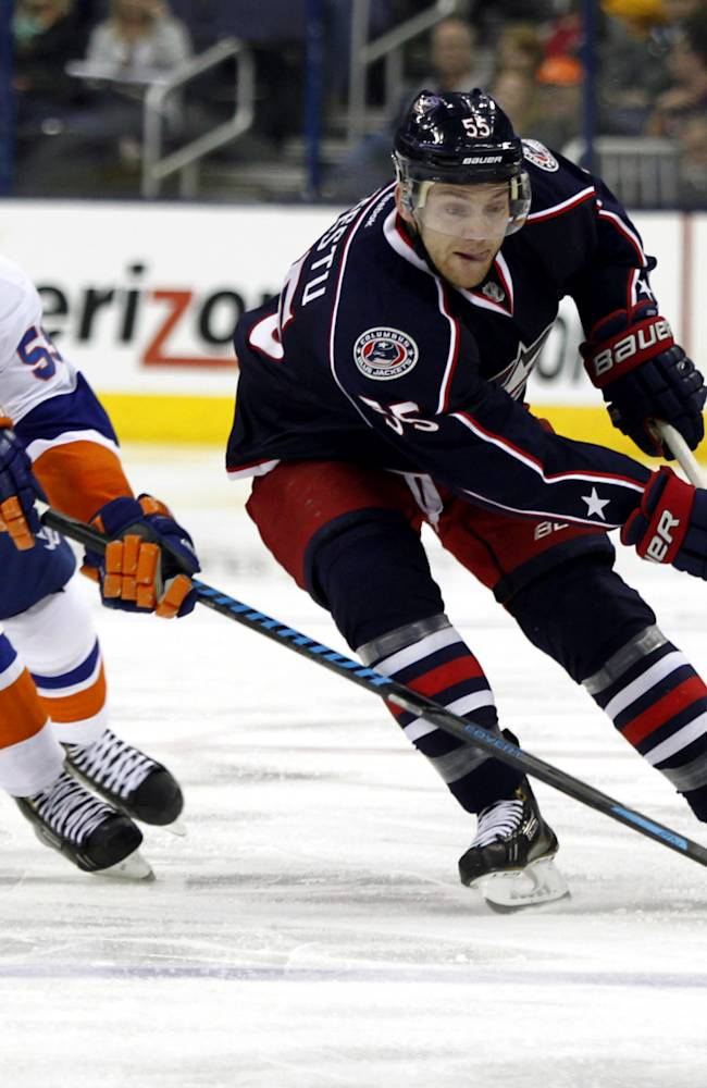 Columbus Blue Jackets' Mark Letestu, right, controls the puck in front of New York Islanders' Casey Cizikas in the second period of an NHL hockey game in Columbus, Ohio, Sunday, April 6, 2014