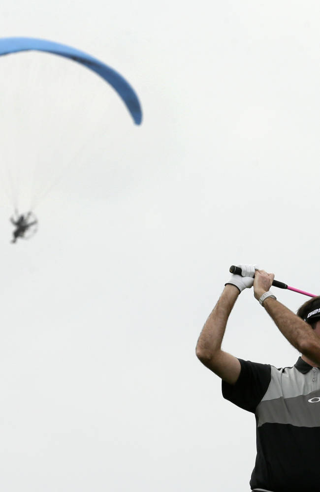 Bubba Watson takes a practice swing before hittting his tee shot on the third hole of the South Course during the second round of the Farmers Insurance Open golf tournament Friday, Jan. 24, 2014, in San Diego