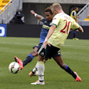IMAGE DISTRIBUTED FOR GUINNESS INTERNATIONAL CHAMPIONS CUP - Manchester City's Scott Sinclair battles for the ball with AC Milan's Ignazio Abate (20) during Guinness International Champions Cup game against Manchester City vs. AC Milan, on Sunday, July 27