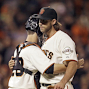 San Francisco Giants catcher Buster Posey, left, embraces pitcher Madison Bumgarner after the Giants defeated the Colorado Rockies 3-0 in a baseball game Tuesday, Aug. 26, 2014, in San Francisco. Bumgarner allowed Colorado only one hit. (AP Photo/Ben Margot)