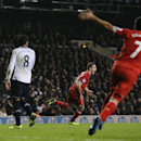 Liverpool's Jordan Henderson, second right, runs as he celebrates scoring his teams second goal during their English Premier League soccer match between Tottenham Hotspur and Liverpool at the White Hart Lane stadium in London Sunday, Dec 15, 2013