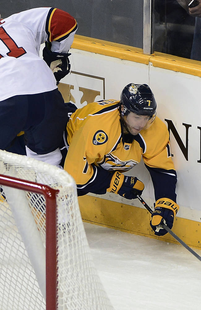 Nashville Predators forward Matt Cullen, right, is checked into the boards by Florida Panthers defenseman Brian Campbell while taking the puck behind the net in the first period of an NHL hockey game on Tuesday, Oct. 15, 2013, in Nashville, Tenn