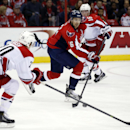 Washington Capitals right wing Eric Fehr (16) skates with the puck as Carolina Hurricanes center Riley Nash (20) defends, in the second period of an NHL hockey game, Tuesday, Dec. 3, 2013, in Washington. The Hurricanes won 4-1 The Associated Press