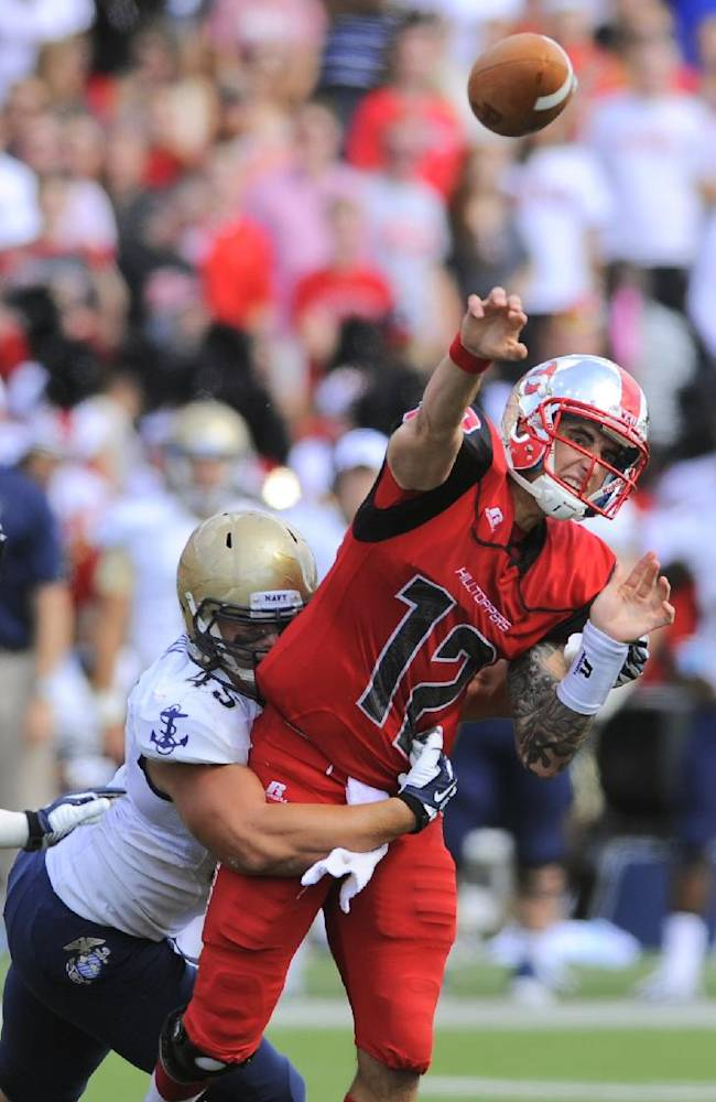 Western Kentucky Hilltoppers quarterback Brandon Doughty (12) is hit by Navy Midshipmen defensive end Paul Quessenberry (45) during the first half of an NCAA college football game on Saturday, Sept. 28, 2013, in Bowling Green, Ky