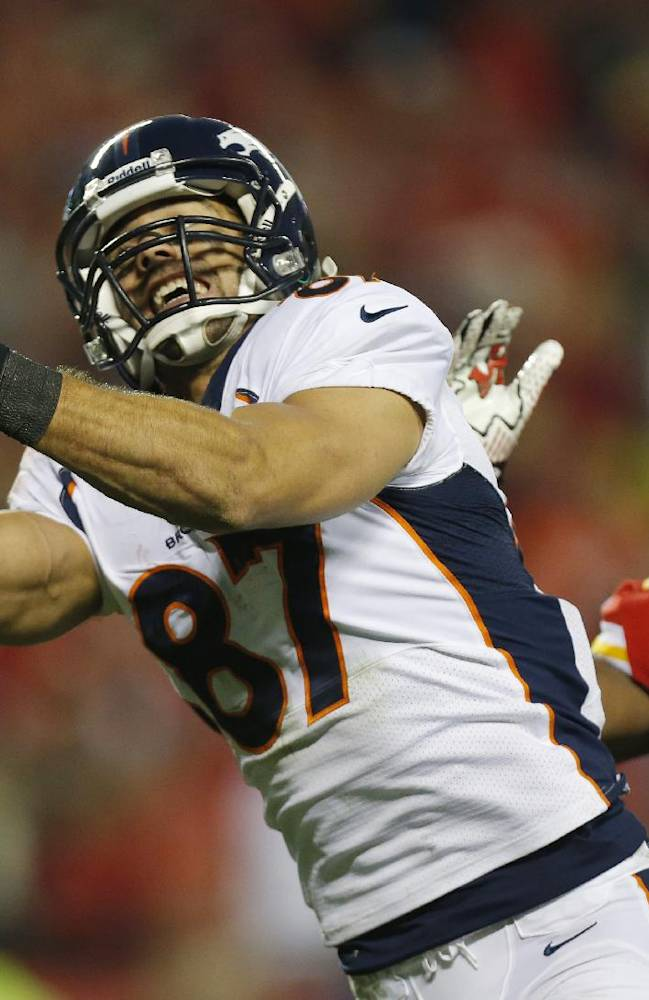In this Dec. 1, 2013 file photo, Denver Broncos wide receiver Eric Decker (87) makes a touchdown reception against Kansas City Chiefs cornerback Brandon Flowers (24) during the second half of an NFL football game in Kansas City, Mo. Where will Maurice Jones-Drew, Decker and Michael Vick wind up. They are some of the best-known players available as NFL free agency begins
