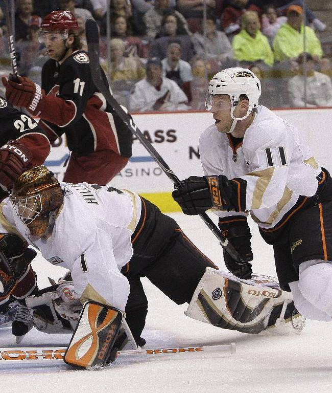 Anaheim Ducks' Jonas Hiller (1), of Switzerland, dives after the puck as Ducks' Saku Koivu (11), of Finland, Phoenix Coyotes' Lee Stempniak (22) and Martin Hanzal (11), of the Czech Republic, all give chase in the second period of an NHL hockey game Saturday, March 6, 2010, in Glendale, Ariz.  The Coyotes defeated the Ducks 4-0