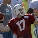 Miami Dolphins quarterback Ryan Tannehill (17) prepares to pass during NFL football training camp in Davie, Fla., Sunday, July 27, 2014 The Associated Press