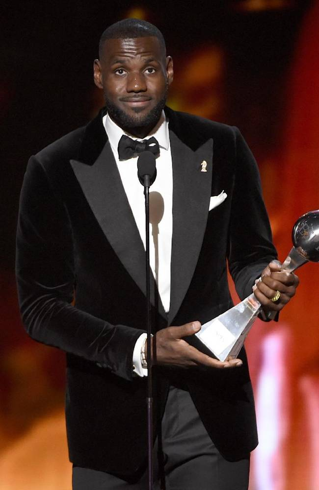 FILE - In this Wed., July 15, 2015 file photo, NBA player LeBron James, of the Cleveland Cavaliers, accepts the award for best championship performance at the ESPY Awards at the Microsoft Theater, in Los Angeles. The NBA star and his company, SpringHill Entertainment, have signed a content creation deal with Warner Bros. that includes potential projects in film, television and other digital properties. Warner Bros. Chairman and CEO Kevin Tsujihara announced the partnership Wednesday, July 22, 2015. (Photo by Chris Pizzello/Invision/AP, File)