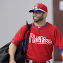 Philadelphia Phillies catcher Wil Nieves walks to the field before a spring training baseball practice Thursday, Feb. 13, 2014, in Clearwater, Fla The Associated Press