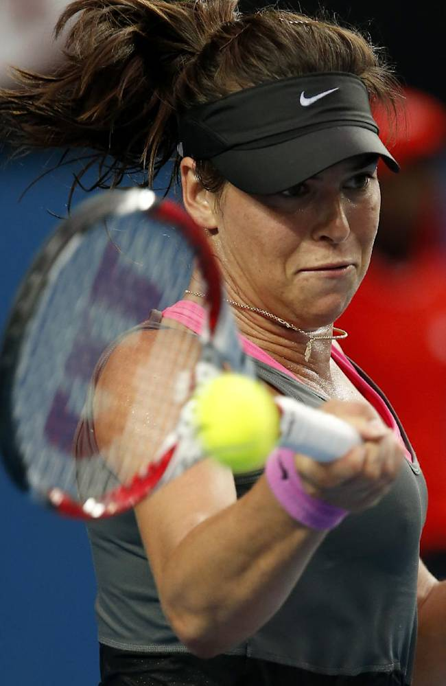 Ajla Tomljanovic of Croatia makes forehand return to Sloane Stephens of the U.S. during their second round match against  at the Australian Open tennis championship in Melbourne, Australia, Thursday, Jan. 16, 2014