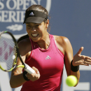 Ana Ivanovic, of Serbia, returns the ball during the second set of her match against Carol Zhao in the Bank of the West Classic tennis tournament in Stanford, Calif., Thursday, July 31, 2014. Ivanovic won 6-1, 6-1. (AP Photo/Jeff Chiu)