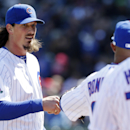 Chicago Cubs starter Jeff Samardzija, left, talks to Emilio Bonifacio as he walks walks back to the dugout during the third inning of a baseball game against the Philadelphia Phillies in Chicago, Saturday, April 5, 2014 The Associated Press