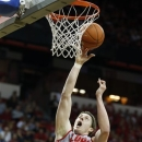 Wyoming's Austin Haldorson covers a shot from New Mexico's Cameron Bairstow during the first half of a Mountain West Conference tournament NCAA college basketball game on Wednesday, March 13, 2013, in Las Vegas. (AP Photo/Isaac Brekken)