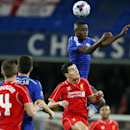 Chelsea's Ramires heads the ball during the English League Cup semifinal second leg soccer match between Chelsea and Liverpool at Stamford Bridge stadium in London, Tuesday, Jan. 27, 2015
