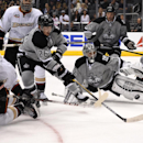 Anaheim Ducks center Nick Bonino, left, scores on Los Angeles Kings goalie Jonathan Quick, third from right, as right wing Daniel Winnik, second from left, defenseman Slava Voynov, third from left, of Russia, defenseman Robyn Regehr, second from right, o