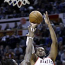 Portland Trail Blazers forward LaMarcus Aldridge, shoots over Denver Nuggets forward Kenneth Faried during the second half of an NBA basketball game in Portland, Ore., Saturday, March 1, 2014. Aldridge, back on the court after sitting out several weeks w