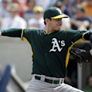 Oakland Athletics' Jarrod Parker throws during the first inning of an exhibition spring training baseball game against the Milwaukee Brewers on Wednesday, March 5, 2014, in Phoenix The Associated Press