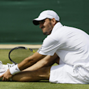 Viktor Troicki of Serbia grimaces as he holds his ankle after slipping as he plays Mikhail Youzhny of Russia in their Men's singles match at the All England Lawn Tennis Championships in Wimbledon, London, Saturday, June 29, 2013. (AP Photo/Kirsty Wigglesworth)