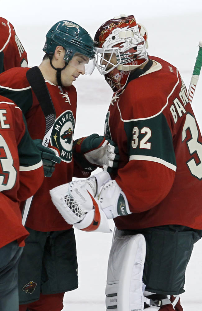 Minnesota Wild center Torrey Mitchell, left, congratulates goalie Niklas Backstrom (32), of Finland, after the Wild defeated the St. Louis Blues 3-1 in a preseason NHL hockey game in St. Paul, Minn., Wednesday, Sept. 25, 2013