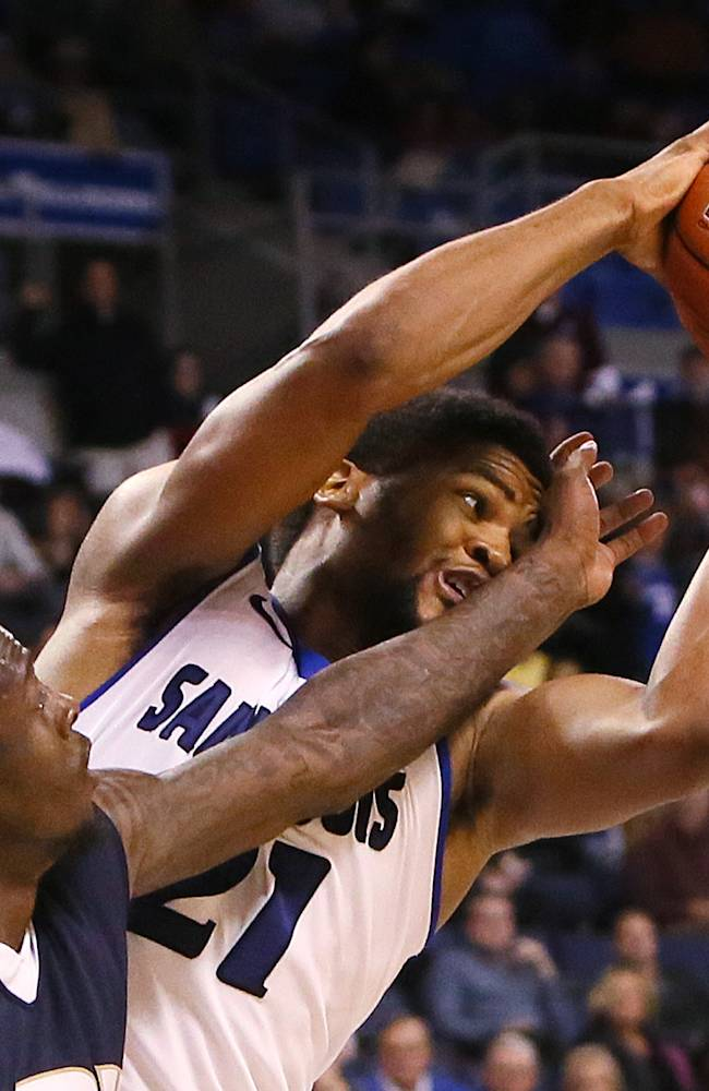 St. Louis University forward Dwayne Evans pulls down a rebound against Oral Roberts guard Korey Billbury in the second half of an NCAA college basketball game, Thursday, Nov. 21, 2013 in St. Louis