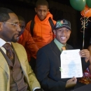 Ray Lewis III, second from right, shows his national letter-of-intent form as his father, former Baltimore Ravens linebacker Ray Lewis Jr., left, his mother Tatyana McCall, and brothers Rahsaan, 12, second from left, and Rayshad, 14, center, watch during a national signing day ceremony in the Lake Mary Prep auditorium in Lake Mary, Fla., Wednesday, Feb. 6, 2013. Lewis signed a letter of intent to play football at the University of Miami, where his father also played college football. (AP Photo/Phelan M. Ebenhack)