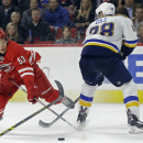 Carolina Hurricanes' Jeff Skinner (53) and St. Louis Blues' Ian Cole (28) chase the puck during the second period of an NHL hockey game in Raleigh, N.C., Friday, Jan. 30, 2015 The Associated Press